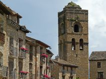 Central square and church tower. Village of Aínsa. Medieval art. Spain. Central square and church tower. Village of Aínsa, in the Aragonese Pyrenees royalty free stock photos