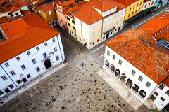 Central square of coastal town Koper in Slovenia. Koper, Slovenia. Central square of coastal town Koper in Slovenia seen from above. Historical buildings with Royalty Free Stock Image