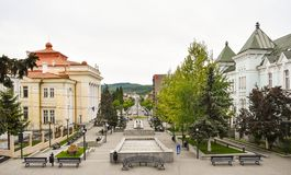 Central square with concrete pavement in the downtown of the modern city Ramnicu Valcea. Romanian travel destination. Ramnicu. Valcea, Romania - 20.05. 2019 stock photography