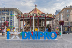 Central square of the Dnepr city with merry-go-round at Independence Day morning. Dnep, Ukraine - August 24, 2016: Central square of the Dnepr city with merry-go stock images