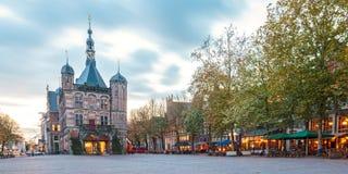 The central square in the Dutch city Deventer. Panoramic evening view of the central square in the historic Dutch city Deventer Stock Image