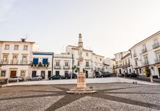Central square of Estremoz with a marble pillory in Manueline st. ESTREMOZ, PORTUGAL – AUGUST 23, 2018: Central square of Estremoz with a marble pillory stock image