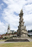 The central square of Kremnica. The baroque Holy Trinity plague column from 1765 – 1772 in central square of Kremnica, Slovakia. In background is the town royalty free stock images