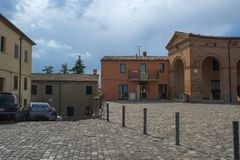 Central square in Mondaino, Italy. Central square in Mondaino city near medieval fortress walls, Italy stock images