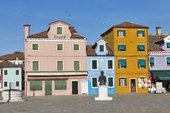 Central square and monument Baldassare Galuppi on island Burano, Italy. Central square and monument to Baldassare Galuppi, byname Il Buranello on the famous royalty free stock photos
