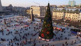 Central square new year celebration beautiful decoration pine tree. Many people walk and celebrate. Winter Vladivostok city Russia. Central square new year stock footage