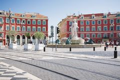 Nice, Provance, Alpes, Cote d`Azur, French  July 31, 2018; Square Massena with red building and fountain royalty free stock images
