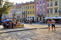 Central square of old Lviv. The central square of old Lviv, medieval architecture, people, tourists and townspeople. Lviv, Ukraine, Europe royalty free stock photo