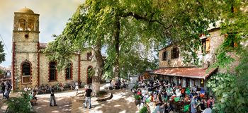 Central Square and Saint Panteleimon church at Palios Panteleimonas, Greece. Palios Panteleimonas, Greece - May 1th, 2018: Panorama of the central square, the royalty free stock photos