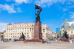 Central square in Vladivostok. VLADIVOSTOK, RUSSIA - JULY 17, 2016: Memorial to the Fighters for the Soviet Power in the Far East and Dalrybvtuz building on royalty free stock photo