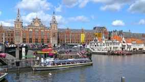 Central Station in Amsterdam, Netherlands. Boat jetty for canal cruises at Central Station, Centraal, Amsterdam, Netherlands, Europe stock video footage