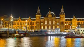 Central Station in Amsterdam Netherlands at night. Central Station in Amsterdam Netherlands Europe at night stock footage