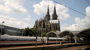 Central station Cologne and Cathedral. Arrival by train to Cologne  - Cathedral towers Royalty Free Stock Photos