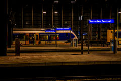 Inside rotterdam central station at night Stock Image