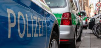 CENTRAL STATIONS, MUNICH, APRIL 6, 2019: blue and green german police cars parking in a row at the central station in royalty free stock photo