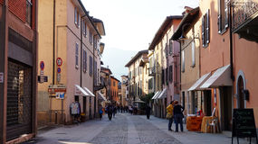 Central street in the center of old small town and comune Iseo in the province of Brescia, Lombardy with walking people Royalty Free Stock Images