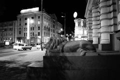 Central street of the evening city in black and white colors Royalty Free Stock Photos
