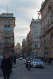 Central street in Milan, Italy, near Piazza Duomo. MILAN, ITALY - January 13, 2016: A lot of traffic in the main street in centre of Milan, Italy Stock Photos
