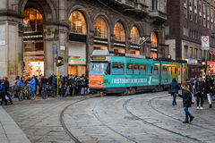 Central street of Milan with many people near tram station, located near Piazza Del Duomo, Italy Stock Photography