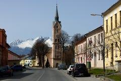 Lubica, Spis Region, Slovakia. Central street of village Lubica and snowy High Tatras mountains - Slovakia royalty free stock photos