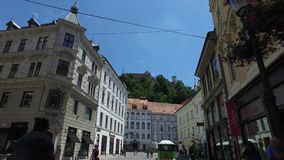 Central streets of the city of Ljubljana the capital and largest city of Slovenia. Churches and castle on the hill stock video footage