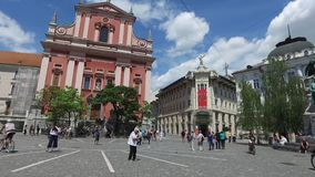 Central streets of the city of Ljubljana the capital and largest city of Slovenia. Churches and castle on the hill stock video