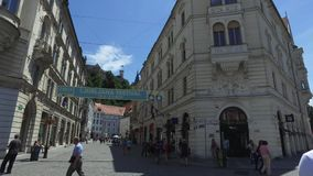 Central streets of the city of Ljubljana the capital and largest city of Slovenia. Churches and castle on the hill stock footage