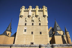 The central tower of an ancient Spanish palace Stock Images