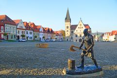 Woodcutter statue and Central square with the Church of St. Aegidius and town hall Bardejov, Slovakia. Central Town Hall Square, Radničné námestie, with stock photo