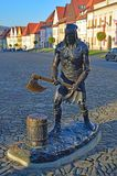Woodcutter statue and Central square with the Church of St. Aegidius and town hall Bardejov, Slovakia. Central Town Hall Square, Radničné námestie, with royalty free stock images