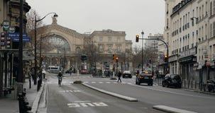 Central train station Paris, France Gare de Est. PARIS, FRANCE - CIRCA 2016: Faubourg Saint-Martin street perspective with cars, pedestrians, buses, Eglise Saint stock footage