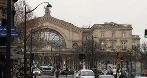 Central train station Paris, France Gare de Est. PARIS, FRANCE - CIRCA 2016: Faubourg Saint-Martin street perspective with cars, pedestrians, buses, Eglise Saint stock video footage