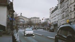 Central train station Paris, France Gare de Est. PARIS, FRANCE - CIRCA 2016: Slow motion, Faubourg Saint-Martin street perspective with cars, pedestrians, buses stock footage