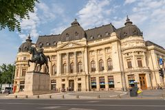 The Central University Library of Bucharest. BUCHAREST, ROMANIA - JUNE 2, 2018: The Central University Library of Bucharest. Frontal view with Carol`s statue stock photo