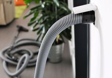 Free Central Vacuum Cleaner Hose Plugged In To Wall Inlet Stock Photography - 179562632