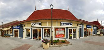 Store panorama in Woodbury Common Premium Outlet mall. CENTRAL VALLEY, NY - MAY 4, 2018: Store panorama in Woodbury Common Premium Outlet mall. The center is stock images