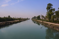 Central view of Mohajir Branch Canal – northern Punjab Pakistan. A peaceful and unique shot taken from canal bridge during beautiful summer Stock Image