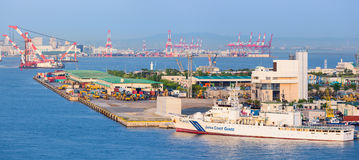 Central wharf with coast guard boat. Kobe City port and cruise terminal. Japan. Royalty Free Stock Images