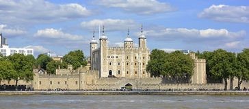 The central White Tower in the Tower of London. The central White Tower within the Tower of London beside the River Thames Stock Photo