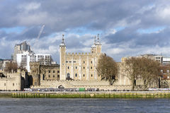 The central White Tower in the Tower of London. The central White Tower within the Tower of London beside the River Thames Royalty Free Stock Images