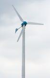 Centrale elettrica del vento contro e tramonto leggero Fotografia Stock