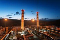 Centrale elettrica, l'area della centrale elettrica Alba di tramonto di luce solare Fotografia Stock