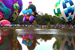 Centralia Illinois Balloon Festival. Hot air balloons around a lake in  Centralia, Illinois Royalty Free Stock Photos