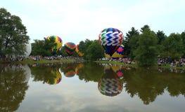 Centralia Illinois Balloon Festival. Hot air balloons around a lake in  Centralia, Illinois Royalty Free Stock Image