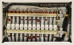 Centralized heating and air conditioning system. Insulated pipes and valves in a centralized heating and air conditioning system stock images