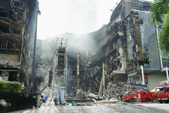 Centralworld shopping complex burned. Centralworld building, secong largest shopping mall in asia, burned and collapsed. red shirt protesters, who support royalty free stock photos