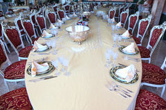 Centre of big oval dinner table Royalty Free Stock Image