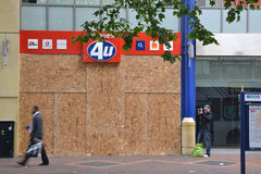 Centre of Birmingham-England Riots 2011-Phone shop. Phones 4 u boarded up after being damadged in the 2011 England riots Stock Photos