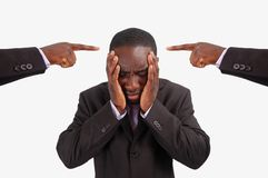 Centre of Blame!. This is an image of a man feeling guilty, with two fingers pointing at him. He is at the centre of blame Royalty Free Stock Photo