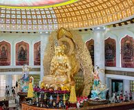 The Centre of Buddhism in Sanya. Temple with Lotus on the ceiling, Golden Buddha and many statues and goddesses. stock image